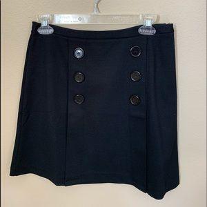 A black Maison Jules Skirt